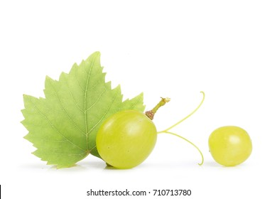 Green grape with leaf isolated on white background