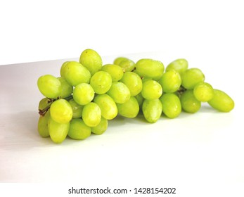 green grape on white background