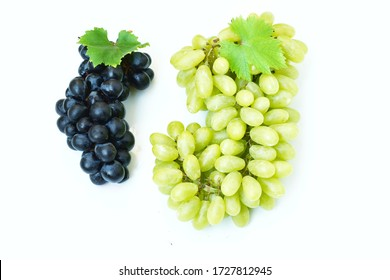Green grapes and black grapes Large bunch of fresh fruit with green leaves and white backgrounds