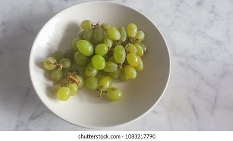 Green grapes dish of marble table