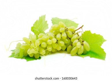 Green grapes with leaf close-up on a white background.