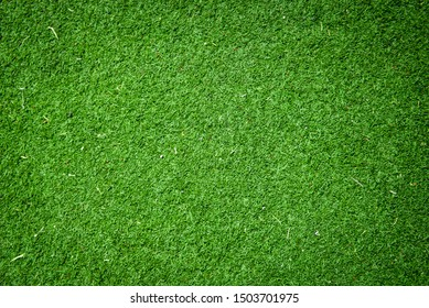 Green grass background texture, green lawn pattern and texture for  background. football field, golf course, park green nature top view.
