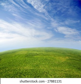 Green grass, blue sky in fish-eye lens