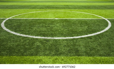 Green grass center of soccer or football field background