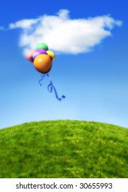 A green grass covered hill against a bright summer sky with isolated cloud and baloons floating past