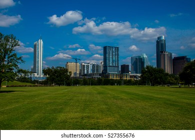 Green grass field or park nice view of the Austin Texas skyline cityscape with frost bank tower and central Texas beauty