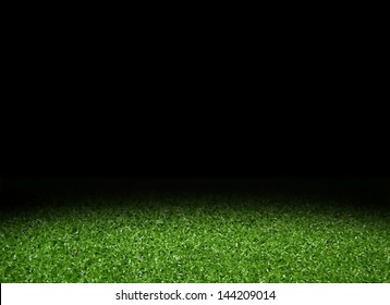 Green grass field with spotlight