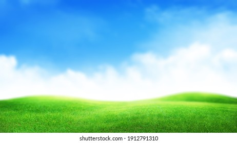 Green grass field and sunny sky with clouds over horizon. Soft focus wide summer landscape backdrop