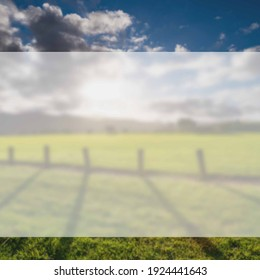 Green grass field, wooden Fence and mountain on horizon at summer morning. American spring sunrise in Denver Colorado USA