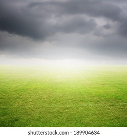 Green Grass fields and rainclouds