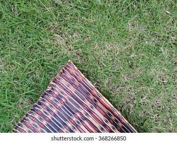 green grass with handmade mat
