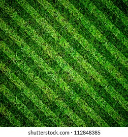 Green grass natural background. Football field. Top view.