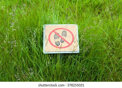 Green grass and a sign do not step. Iceland.