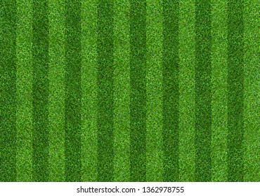 Green grass soccer field background with abstract pattern.