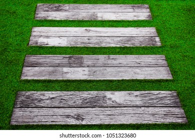 Green grass stair step,Top view green grass step stairs for interior background.Green artificial grass on stair/step, background and textures