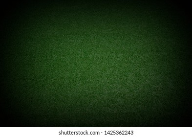 green grass texture background with dark shadow border present football field with the dark and spotlight