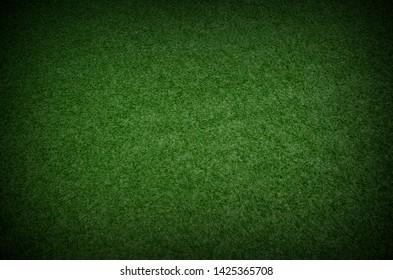 green grass texture background with dark shadow border