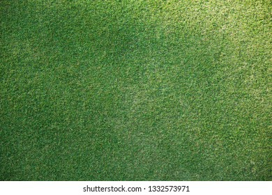 Green grass texture background golf course or football from a top view