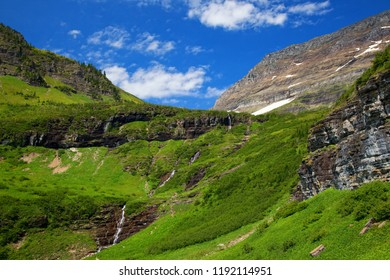 Green grass and waterfalls along the Going to the Sun Road in Glacier National Park, Montana, USA