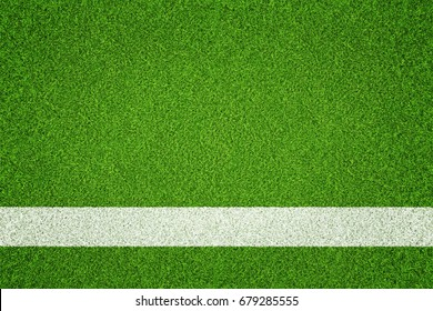 Green grass with white line painted. Top view