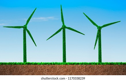 Green grass in wind turbines shape, on blue sky and soil cross section background, concept of ECO, renewable energy and circular economy.
