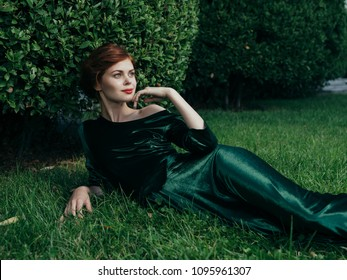 green grass and woman in a silk dress