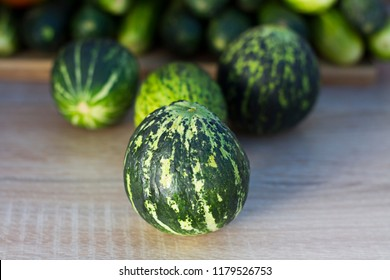 Green grocery vegetables: Organic tomatoes, fresh organic cucumber and unripe watermelon