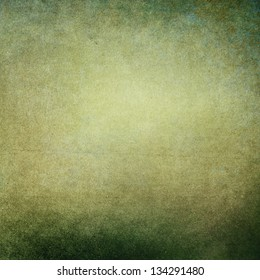 Green grunge background with a faded central area for copy space.