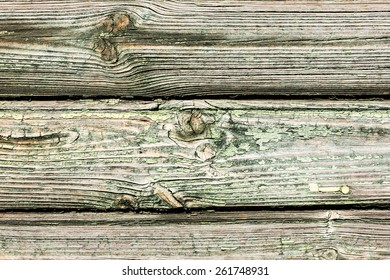 Green grunge wooden surface with peeling paint.