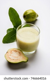 Green Guava Smoothie in glass, also known as Amrud, Jaam or peru juice in India. . selective focus