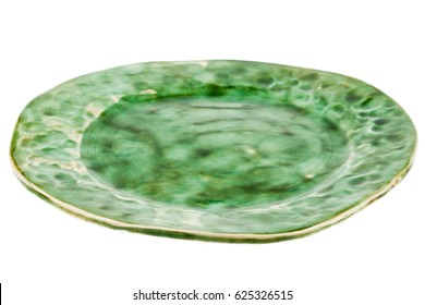 Green handmade pottery plate isolated on white background