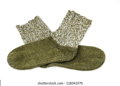 Green handmade socks in front of a white background