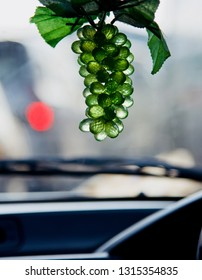 Green hanging artificial grapes isolated showpiece object photo