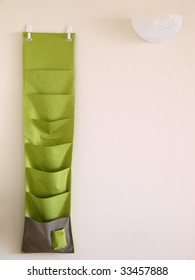 The green hanging bag is used for office.