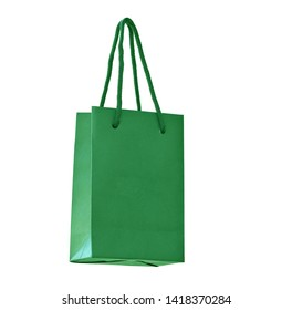 Green hanging paper shopping bag on white. Bottom view, isolated on white