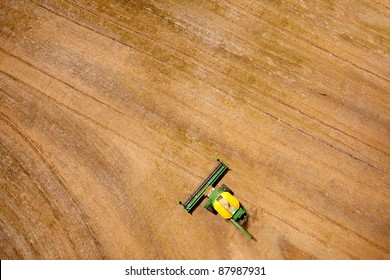 Green harvester in a lentil field creating an abstract background texture