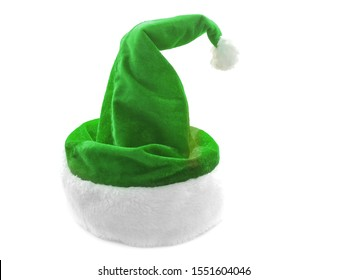 Green hat isolated on a white background. New Year's hat for the elf. Wicked hat for an elf. Green hat with white fur