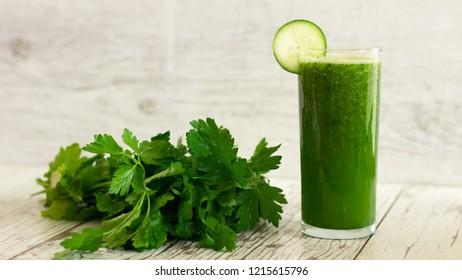 Green healthy detox cucumber, lemon and parsley juice