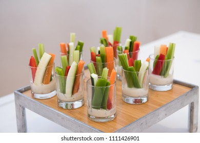 Green healthy gluten-free vegetarian salad mix appetizer snacks on catering event table.