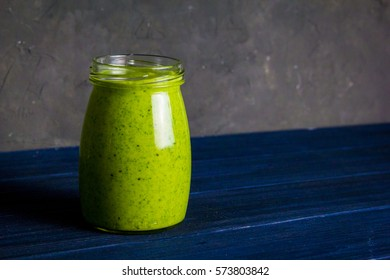 Green healthy smoothie with spinach and avocado