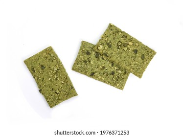 Green Healthy snack: cereal crunchy multigrain cereal flax seed pumpkin, coriander, sunflower seeds protein bread bar. Protein albumen source. Salted diet crispy crackers. Wholemeal.