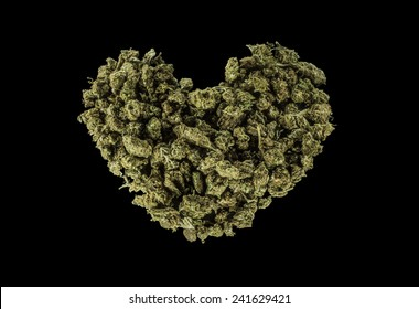 Green heart made of marijuana isolated on a black background