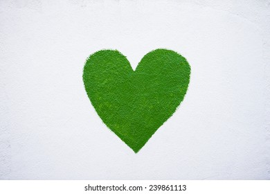 Green heart painted on a wall