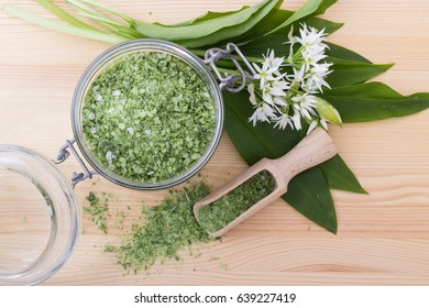Green herbal salt of wild garlic and wooden spoon