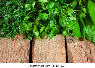 green herbs on a wooden background
