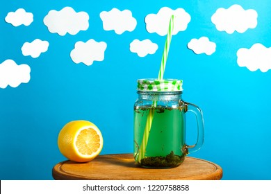 green herbs tea, on a blue background