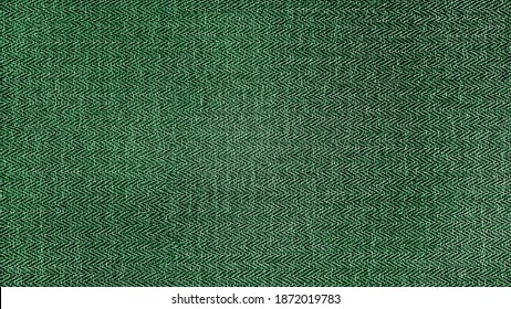 green herringbone tweed pattern, wool fabric background texture. interior material background. illumination background.
