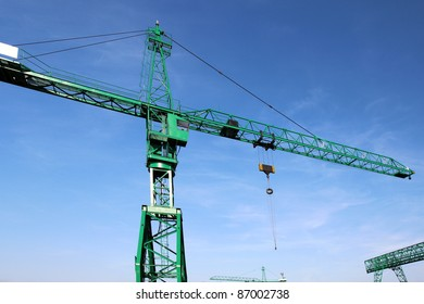 green high crane under blue sky