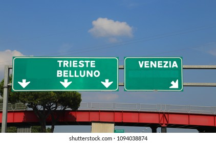 green highway sign in Italy indicating the road to Venice Belluno and Trieste