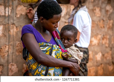 Green Hill School, Tsavo East, Kenya - August 2018: Beautiful black African woman holding her baby